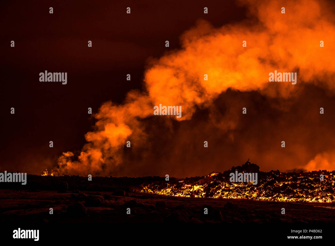 Lava fountains at night, eruption at the Holuhraun Fissure, near the Bardarbunga Volcano, Iceland. August 29, 2014 a fissure eruption started in Holuhraun at the northern end of a magma intrusion, which had moved progressively north, from the Bardarbunga volcano. Bardarbunga is a stratovolcano located under Vatnajokull, Iceland's most extensive glacier. Picture Date-Sept. 2, 2014 - Stock Image