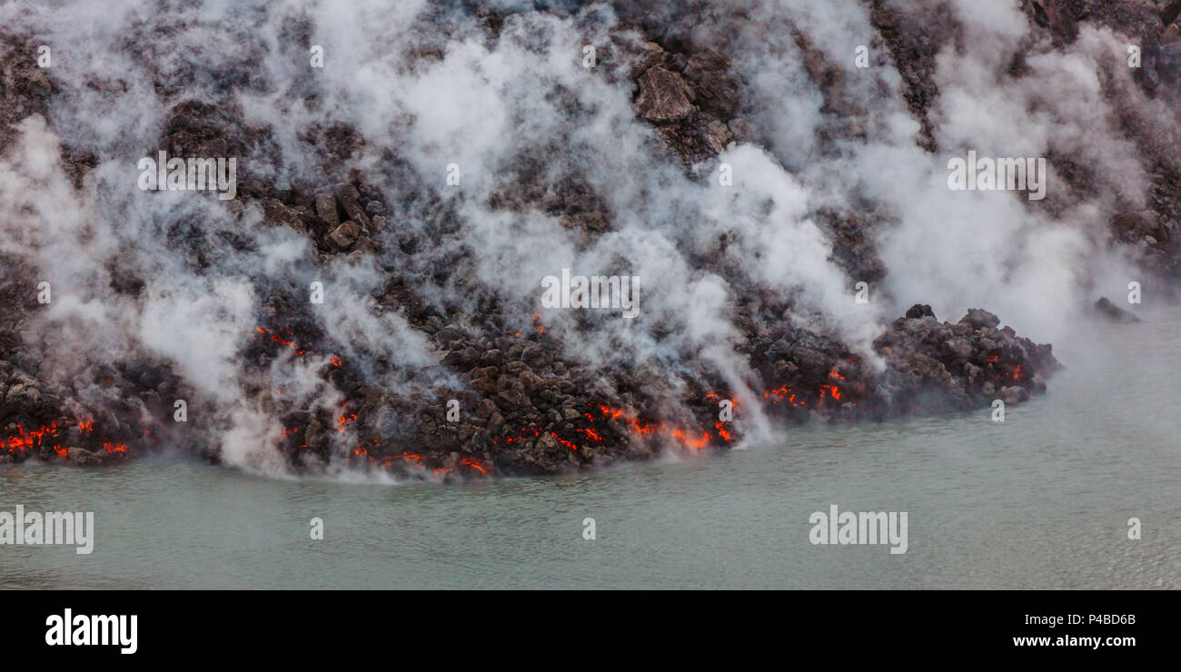 Lava and plumes creeping in the Jokulsa a Fjollum river. August 29, 2014 a fissure eruption started in Holuhraun at the northern end of a magma intrusion, which had moved progressively north, from the Bardarbunga volcano. Bardarbunga is a stratovolcano located under Vatnajokull, Iceland's most extensive glacier. Picture Date-October 30, 2014 - Stock Image
