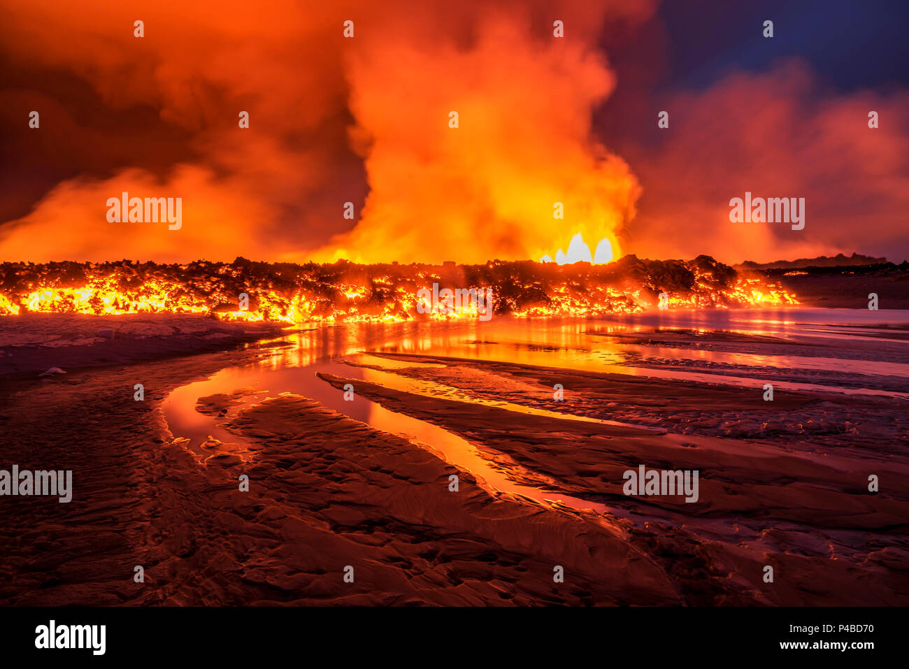Glowing lava from the eruption at the Holuhraun Fissure, near the Bardarbunga Volcano, Iceland. August 29, 2014, a fissure eruption started in Holuhraun at the northern end of a magma intrusion, which had moved progressively north, from the Bardarbunga volcano. Picture date- Sept 2, 2014 Stock Photo