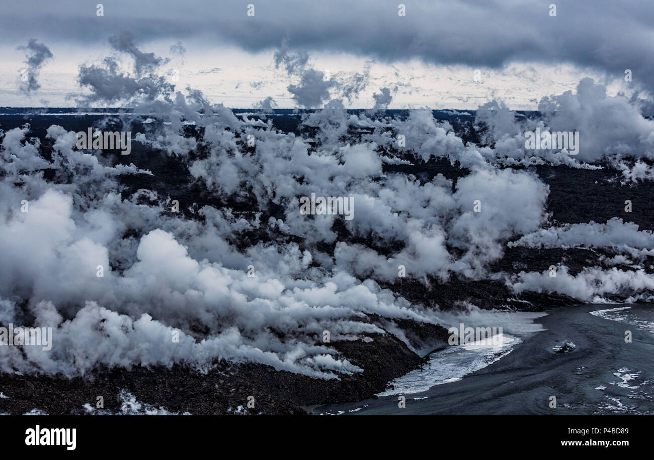 Aerial view of lava and steam. August 29, 2014 a fissure eruption started in Holuhraun at the northern end of a magma intrusion, which had moved progressively north, from the Bardarbunga volcano. Bardarbunga is a stratovolcano located under Vatnajokull, Iceland's most extensive glacier. Picture Date: October 30, 2014 Stock Photo