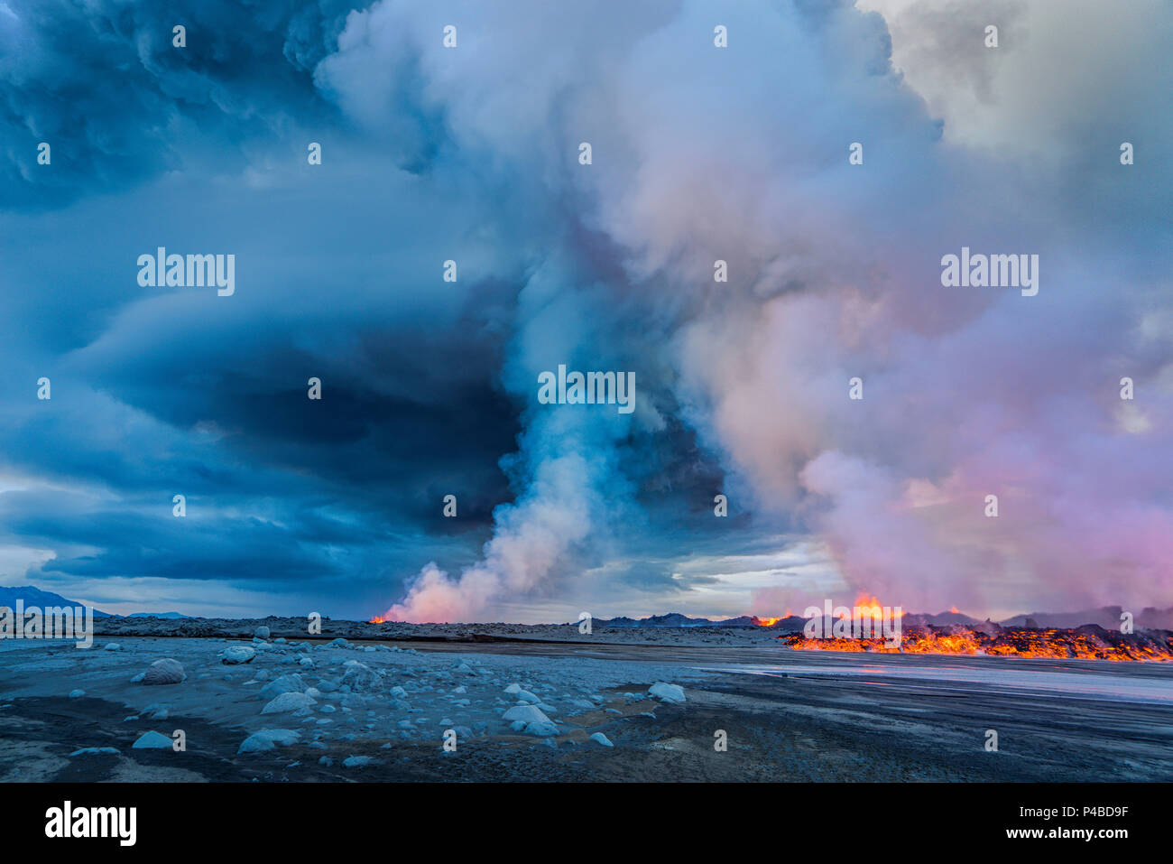Volcano Eruption at the Holuhraun Fissure near Bardarbunga Volcano, Iceland. A late afternoon view of part of the Holuhraun fissure erupting as lava and steam rise into the air near the Bardarbunga Volcano, Iceland. Bardarbunga is a subglacial stratovolcano located under the ice cap of Vatnajokull glacier. Picture date- Sept. 2, 2014 - Stock Image