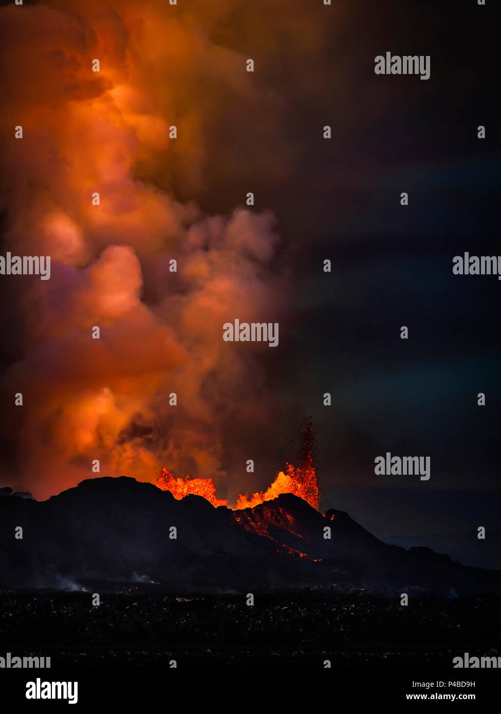 Lava and plumes from the Holuhraun Fissure by the Bardarbunga Volcano, Iceland. August 29, 2014 a fissure eruption started in Holuhraun at the northern end of a magma intrusion, which had moved progressively north, from the Bardarbunga volcano. Bardarbunga is a stratovolcano located under Vatnajokull, Iceland's most extensive glacier. Picture Date: Sept, 20, 2014 - Stock Image