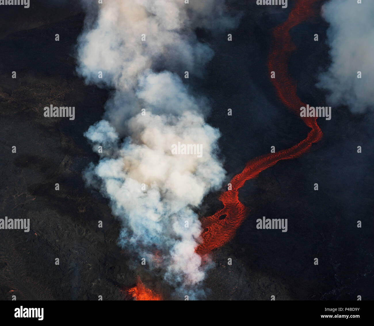 Aerial view of lava and steam. August 29, 2014 a fissure eruption started in Holuhraun at the northern end of a magma intrusion, which had moved progressively north, from the Bardarbunga volcano. Bardarbunga is a stratovolcano located under Vatnajokull, Iceland's most extensive glacier. Picture Date: September 3, 2014 Stock Photo