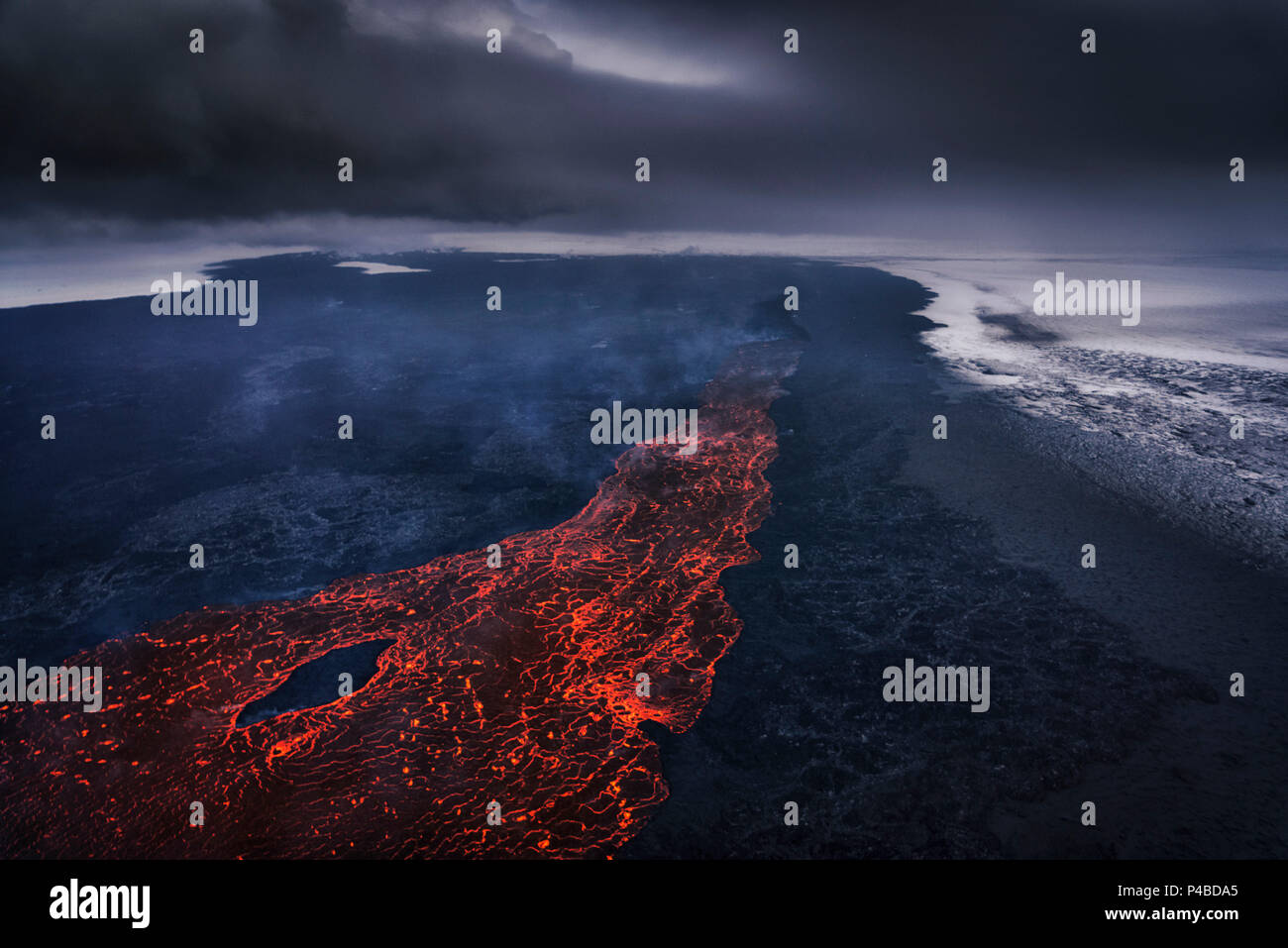 Aerial view of lava and plumes. August 29, 2014 a fissure eruption started in Holuhraun at the northern end of a magma intrusion, which had moved progressively north, from the Bardarbunga volcano. Bardarbunga is a stratovolcano located under Vatnajokull, Iceland's most extensive glacier. Picture Date-October 30, 2014 - Stock Image
