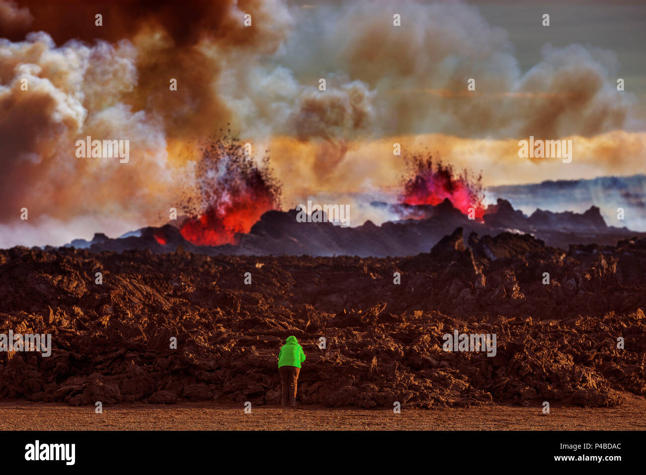 Person close to the new lava. August 29, 2014 a fissure eruption started in Holuhraun at the northern end of a magma intrusion, which had moved progressively north, from the Bardarbunga volcano. Bardarbunga is a stratovolcano located under Vatnajokull, Iceland's most extensive glacier. Picture Date-September 20, 2014 - Stock Image