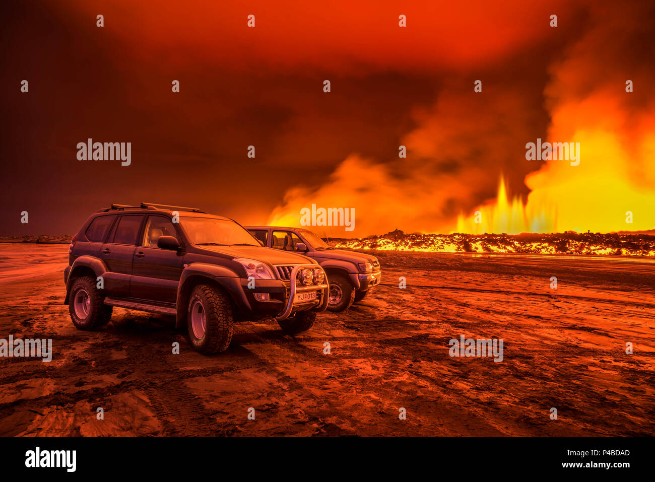 SUVs close to the Eruption at Holuhraun, near the Bardarbunga Volcano, Iceland. August 29, 2014 a fissure eruption started in Holuhraun at the northern end of a magma intrusion, which had moved progressively north, from the Bardarbunga volcano. Picture Date-Sept. 2, 2014 - Stock Image