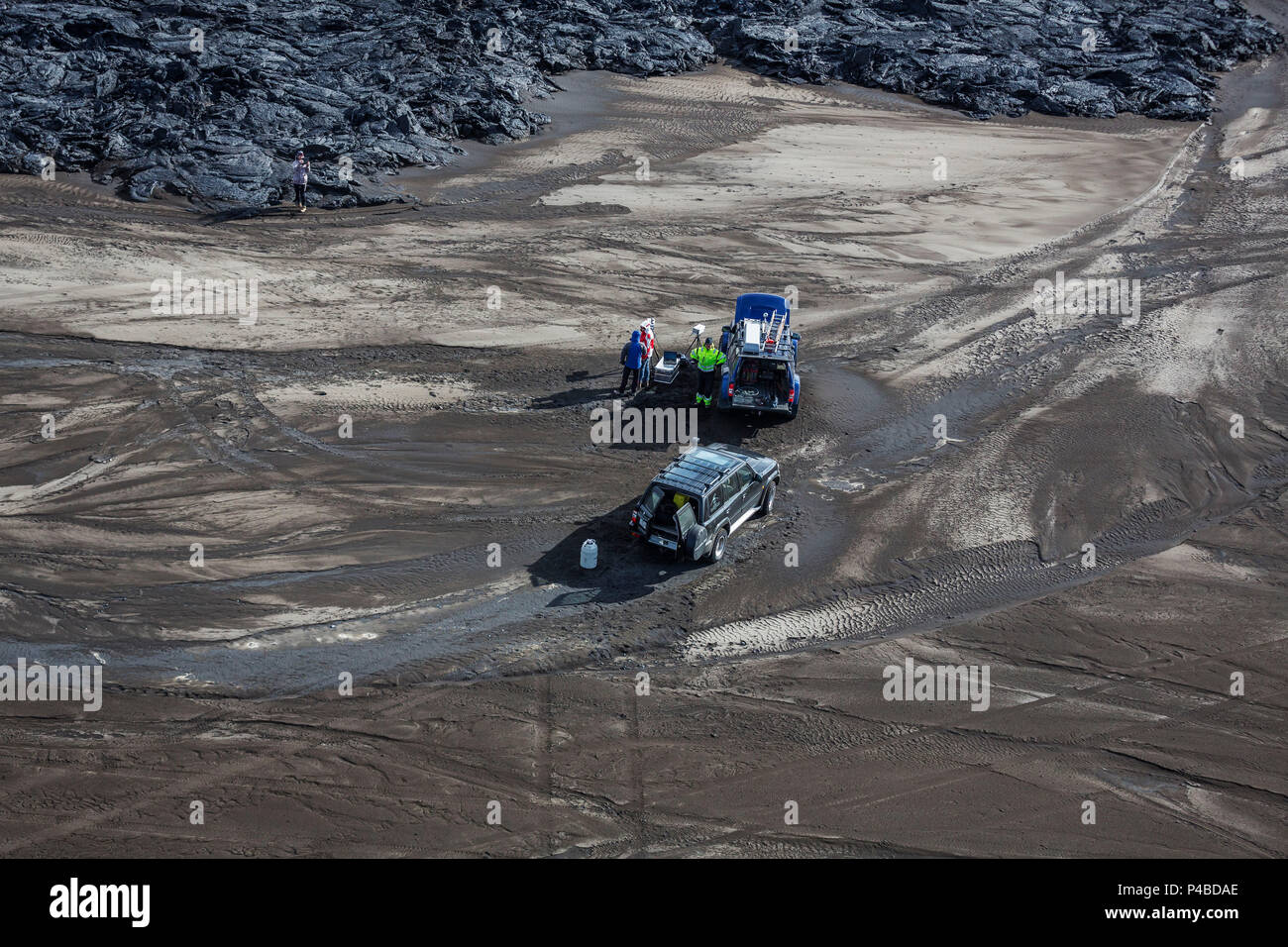 Aerial view of scientists and their jeeps by the lava flows. August 29, 2014 a fissure eruption started in Holuhraun at the northern end of a magma intrusion, which had moved progressively north, from the Bardarbunga volcano. Picture Date: September 3, 2014 - Stock Image