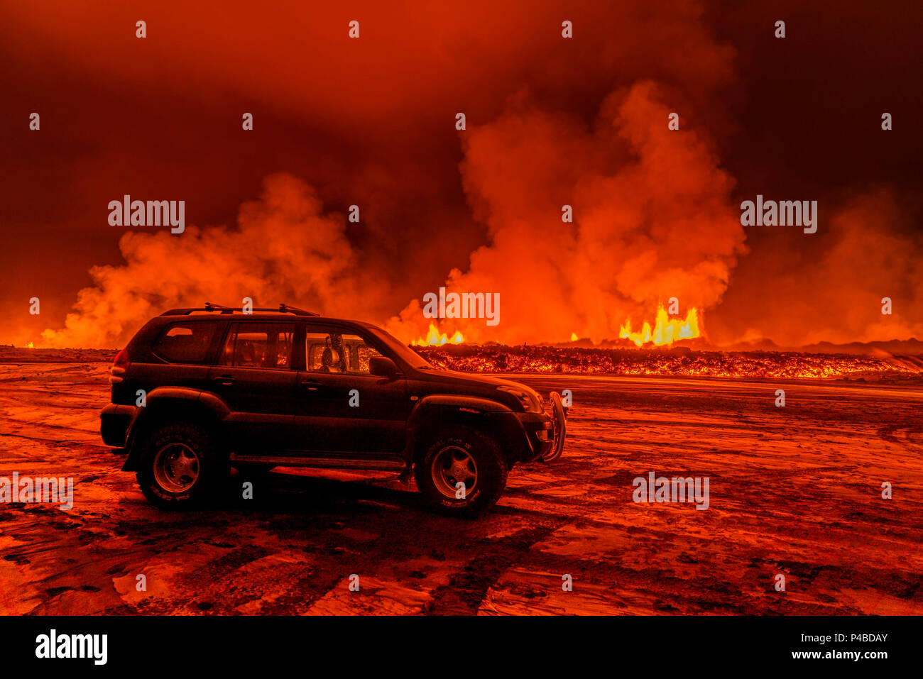 SUV close to the Eruption at Holuhraun, near the Bardarbunga Volcano, Iceland. August 29, 2014 a fissure eruption started in Holuhraun at the northern end of a magma intrusion, which had moved progressively north, from the Bardarbunga volcano. Picture Date-Sept. 2, 2014 - Stock Image