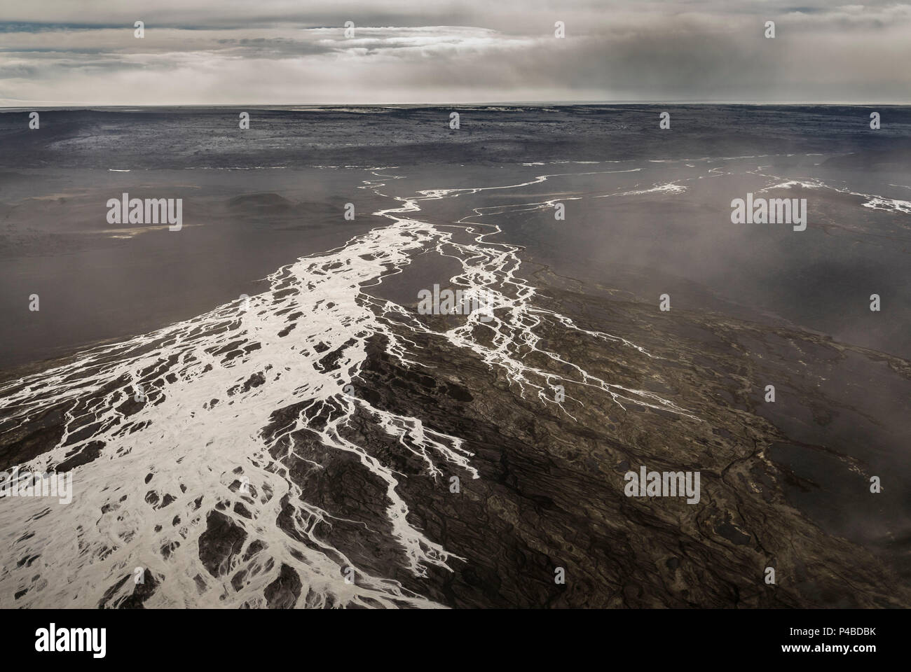 Dust storms over lava fields by Holuhraun. August 29, 2014 a fissure eruption started in Holuhraun at the northern end of a magma intrusion, which had moved progressively north, from the Bardarbunga volcano. Bardarbunga is a stratovolcano located under Vatnajokull, Iceland's most extensive glacier. - Stock Image