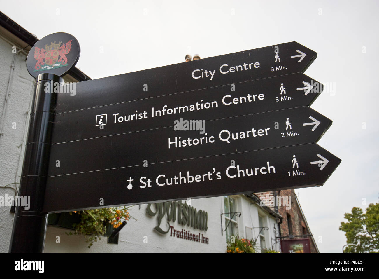 Tourist information sign and walking distances to places in the historic quarter Carlisle Cumbria England UK - Stock Image
