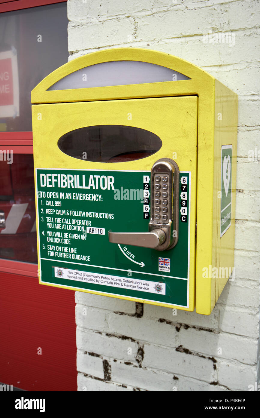 public access defibrillator with emergency keypad lock small local fire station cumbria fire and rescue service Aspatria Cumbria England UK - Stock Image