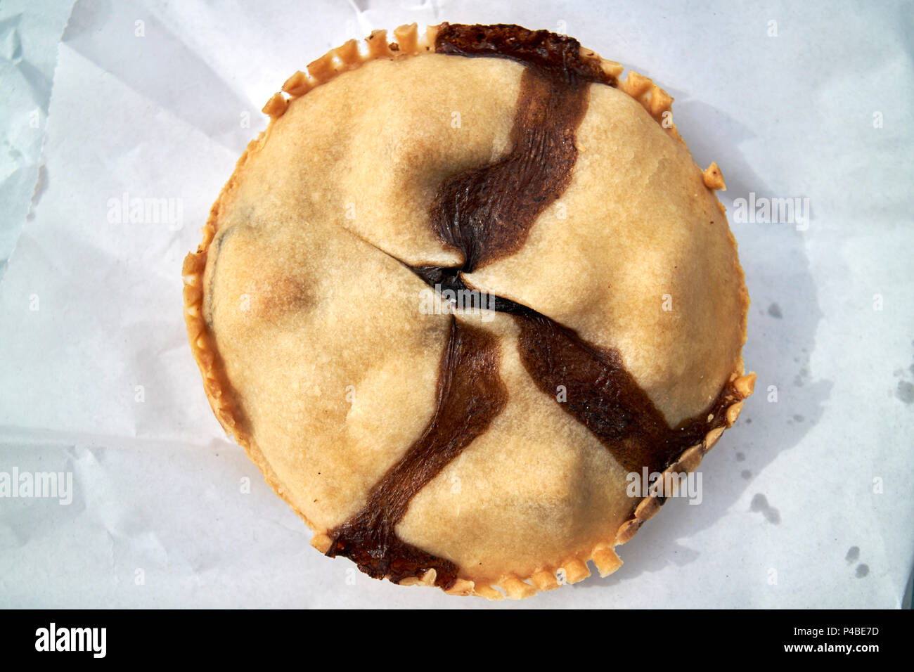 small hand made artisan meat pie Cumbria England UK - Stock Image