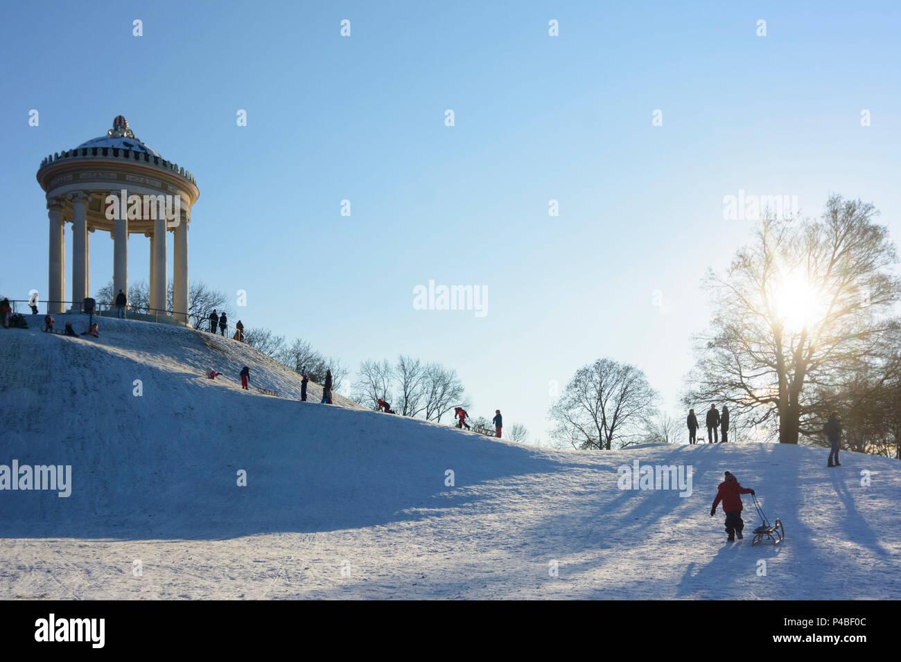 München, Munich, children, kids, sledding, sleigh, sled, sledge, Monopteros in the Englischer Garten (English Garden), Upper Bavaria, Bavaria, Germany - Stock Image