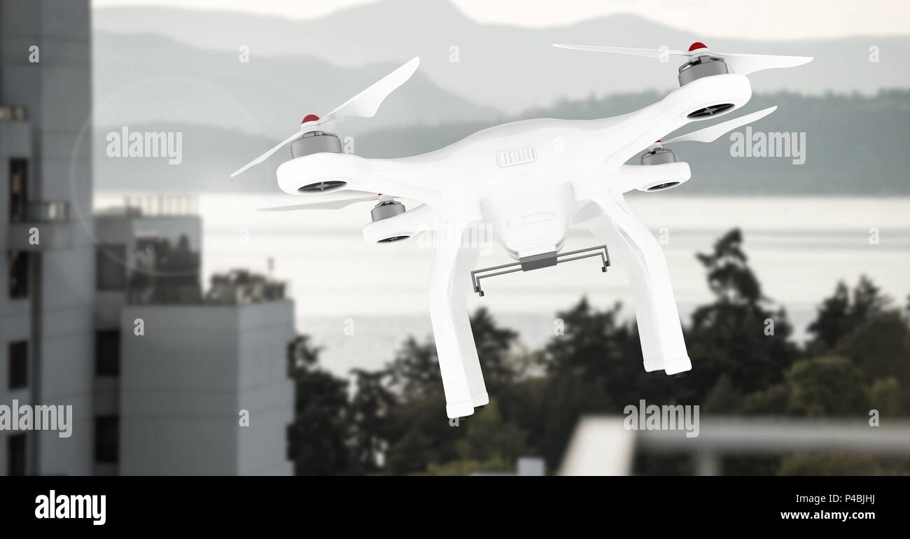 Drone flying by mountain building - Stock Image