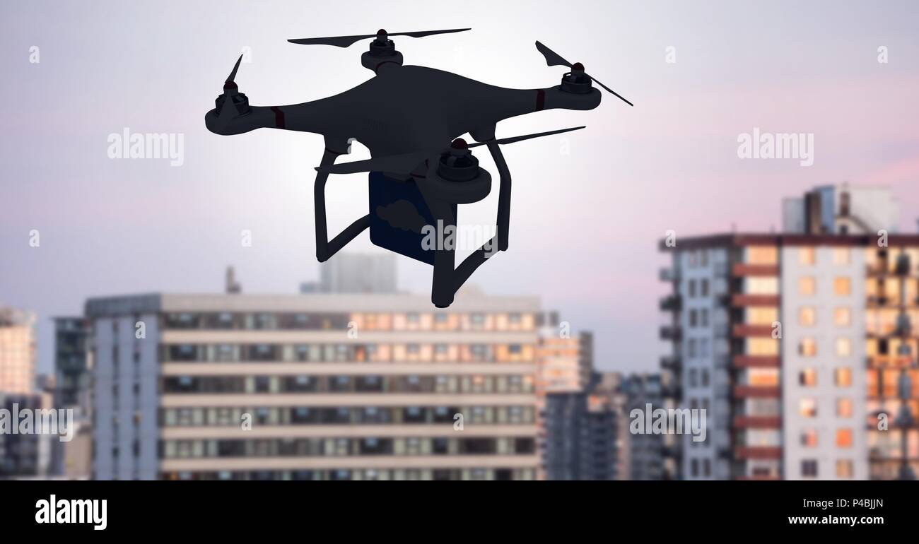 Drone flying over city - Stock Image