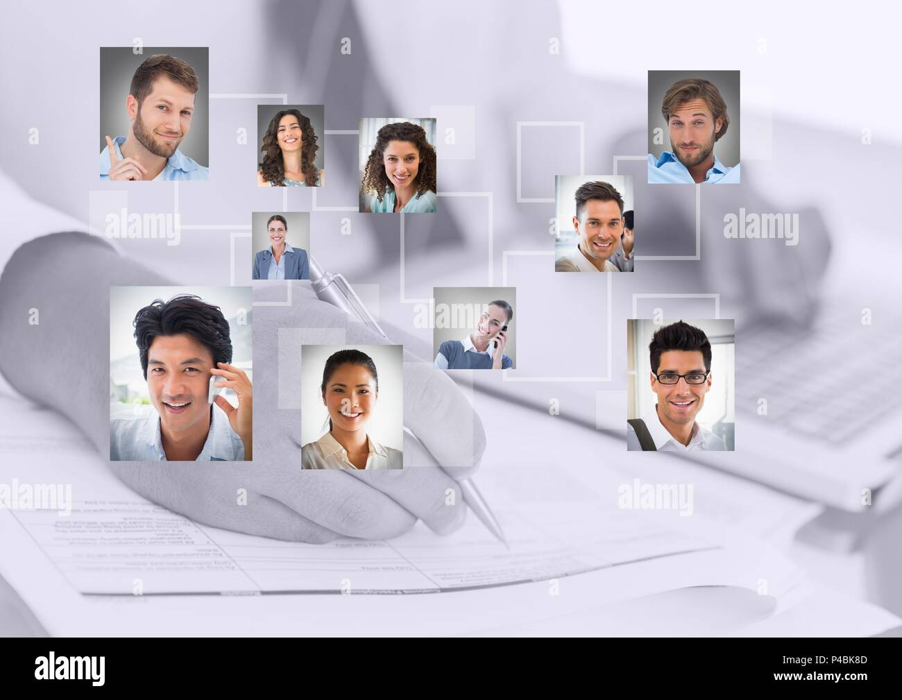 Composite image of businessperson writing with portraits picture - Stock Image