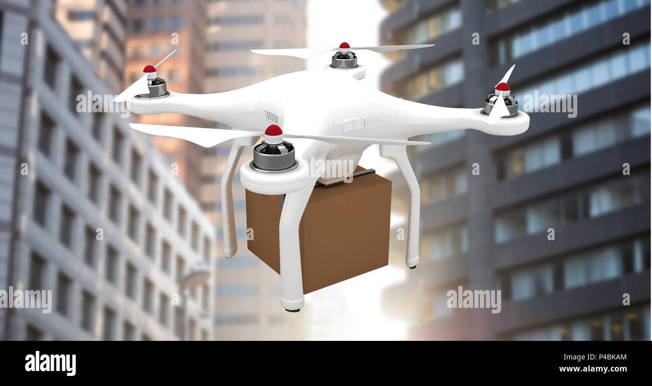 Drone flying by city buildings with delivery parcel box - Stock Image
