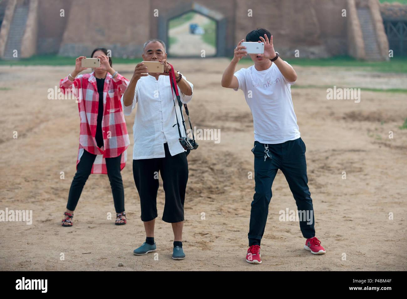 Tourists snap phone photographs at Zhenglanqi Wuyi Farm, Inner Mongolia, China, Inner Mongolia, China - Stock Image