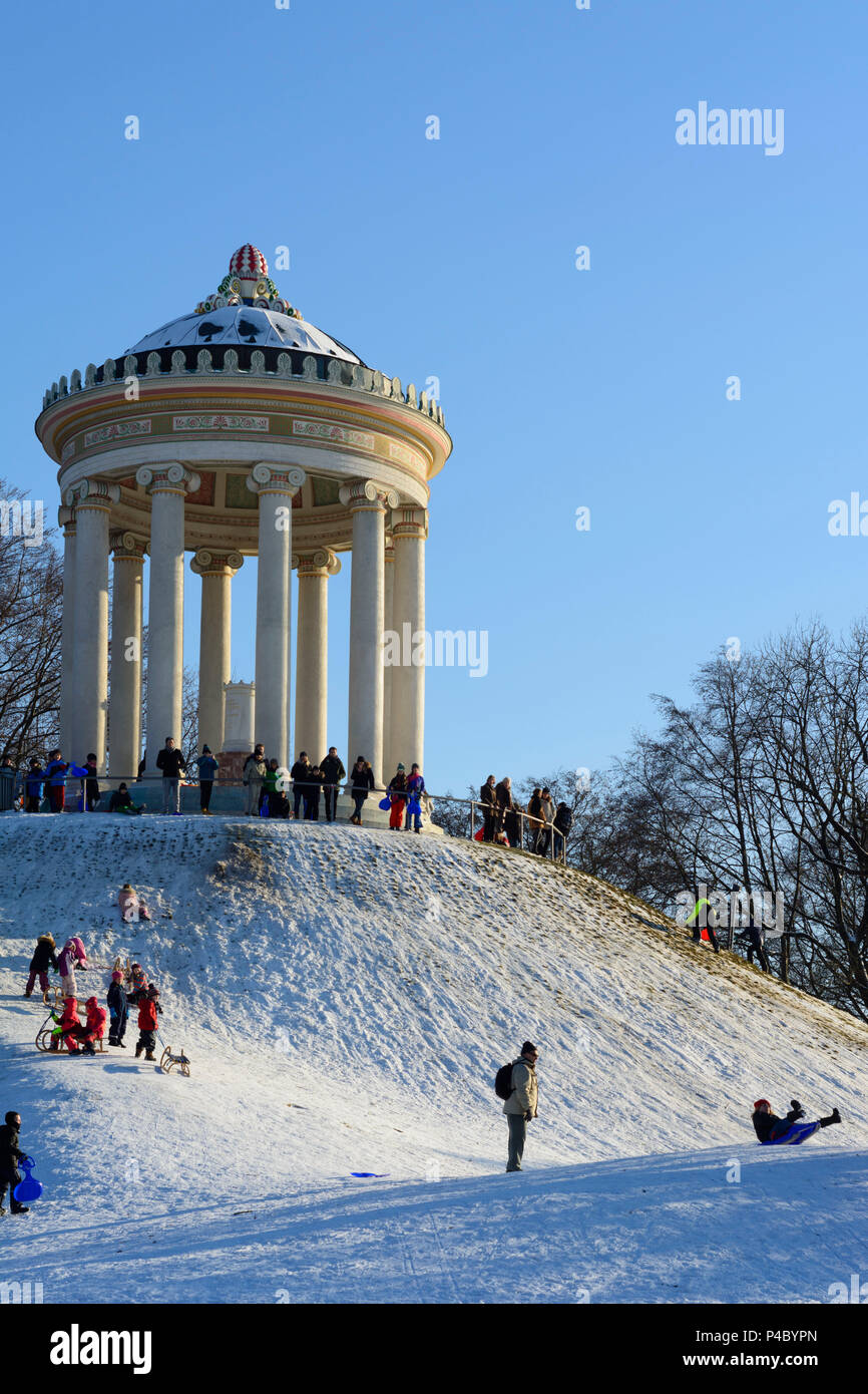 München, Munich, children, kids, sledding, sleigh, sled, sledge, Monopteros in the Englischer Garten (English Garden), Upper Bavaria, Bavaria, Germany - Stock Image