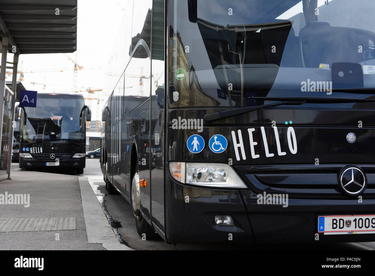 Vienna, 'Hellö' long distance bus of ÖBB Austrian Railways at bus station, 04. Wieden, Wien, Austria - Stock Image
