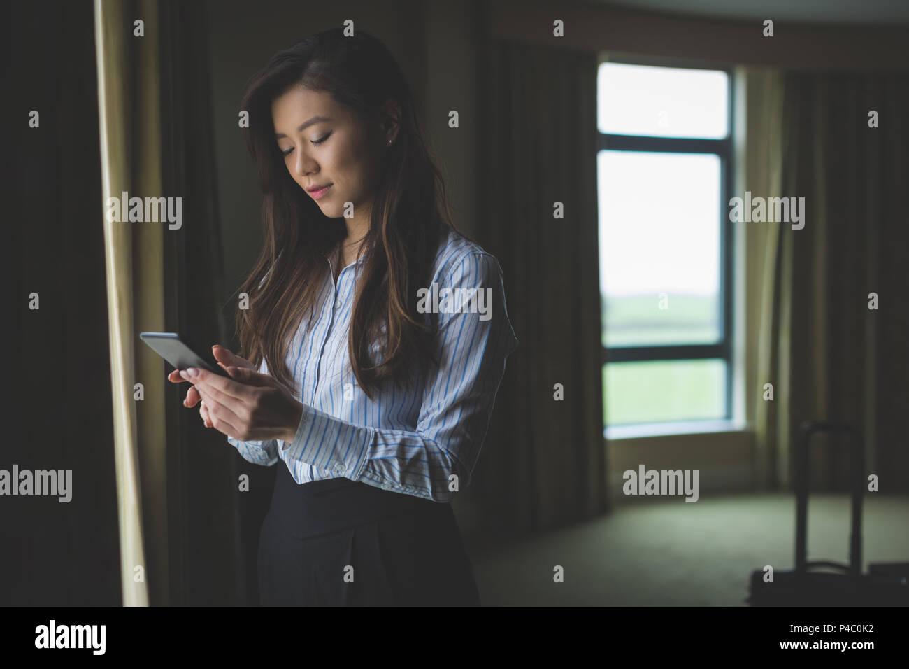 Businesswoman using mobile phone Stock Photo