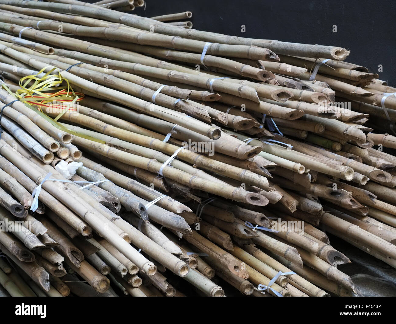 View of a pile of Bamboo scaffolding stored on the ground in Hong Kong - Stock Image