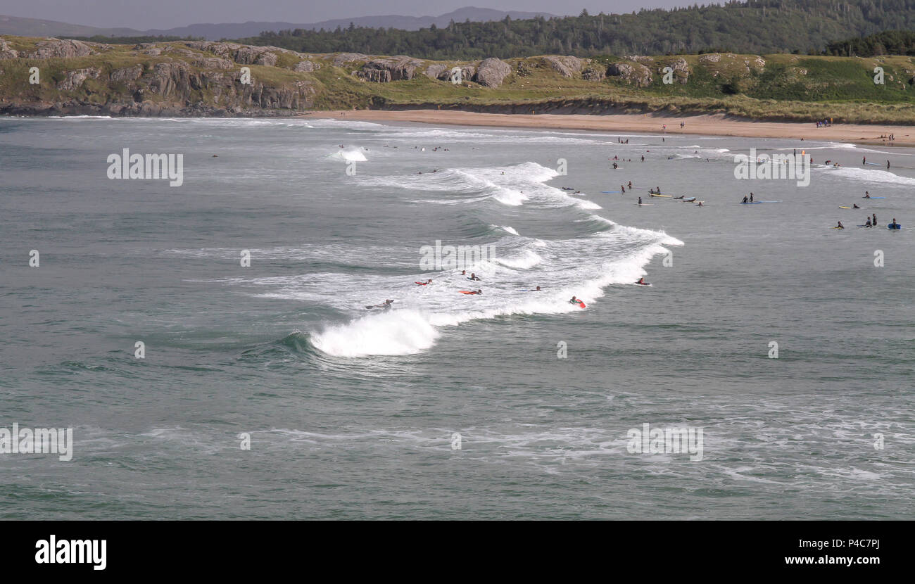People learning to surf on beach in Ireland - Marble Hill beach County Donegal. - Stock Image