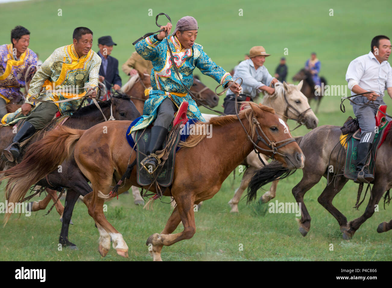 Young horsemen demonstrate team riding, Zhenglanqi Wuyi Farm, Inner Mongolia, China, Inner Mongolia, China - Stock Image