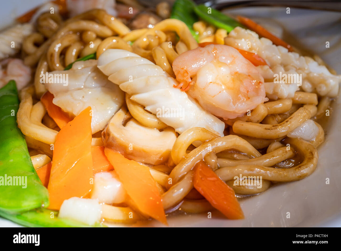 plate of stir fried seafood udon noodle ...