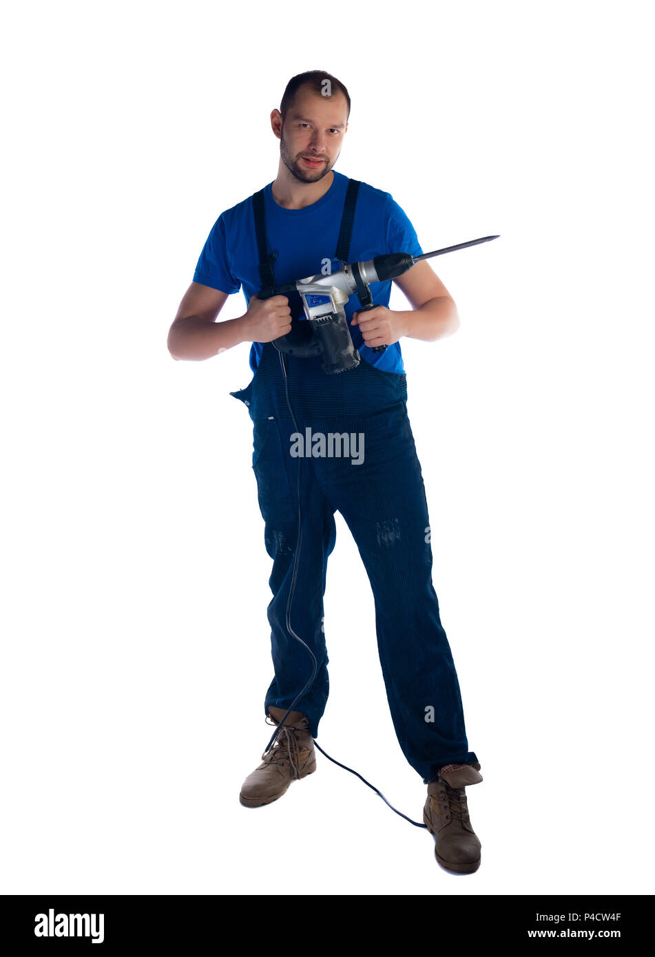 Professional handyman isolated on white holding and showing his drill - Stock Image