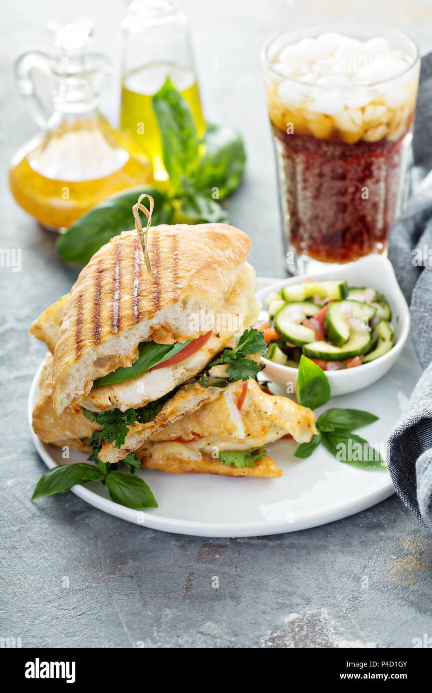 Grilled panini sandwich with chicken and cheese - Stock Image