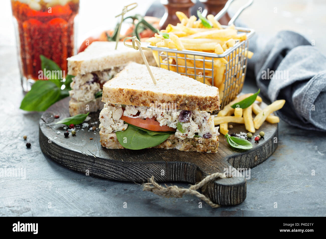 Chicken salad sandwich with spinach and tomato - Stock Image