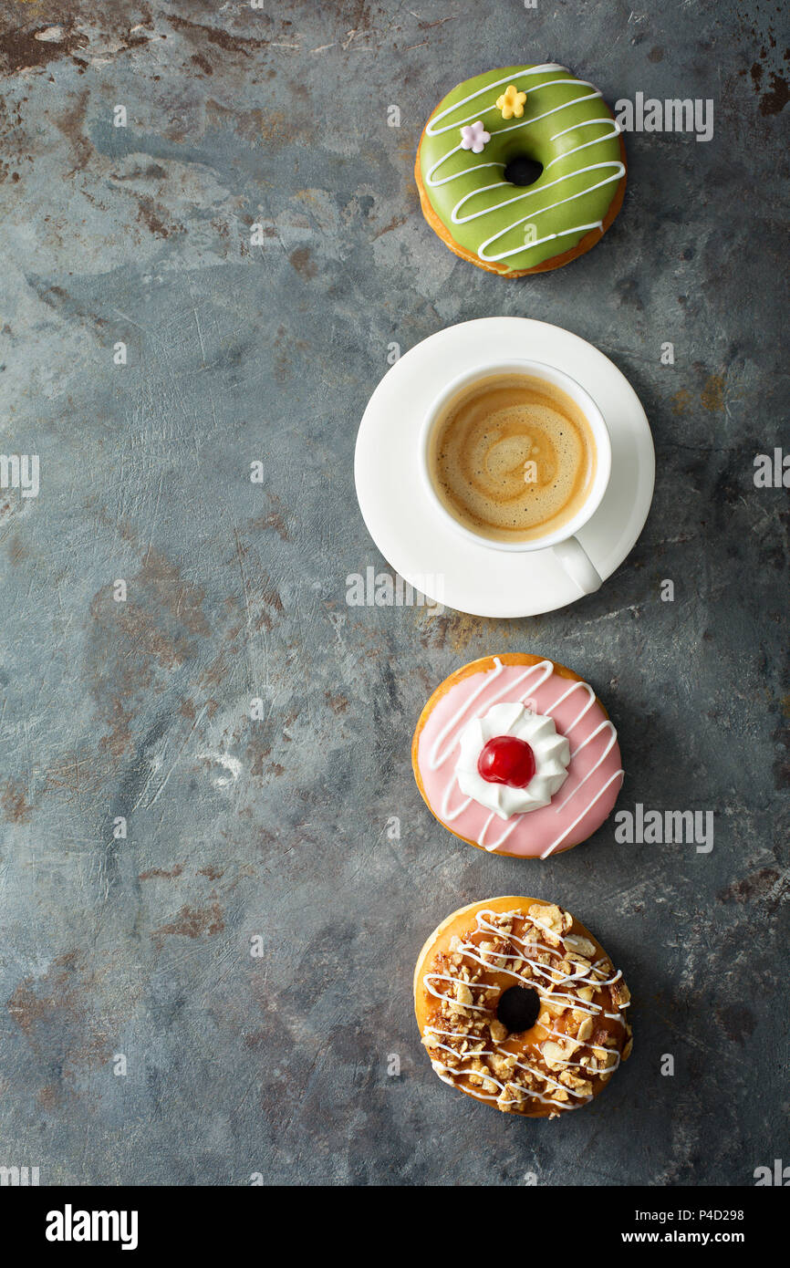 Sweet donuts with coffee overhead view - Stock Image