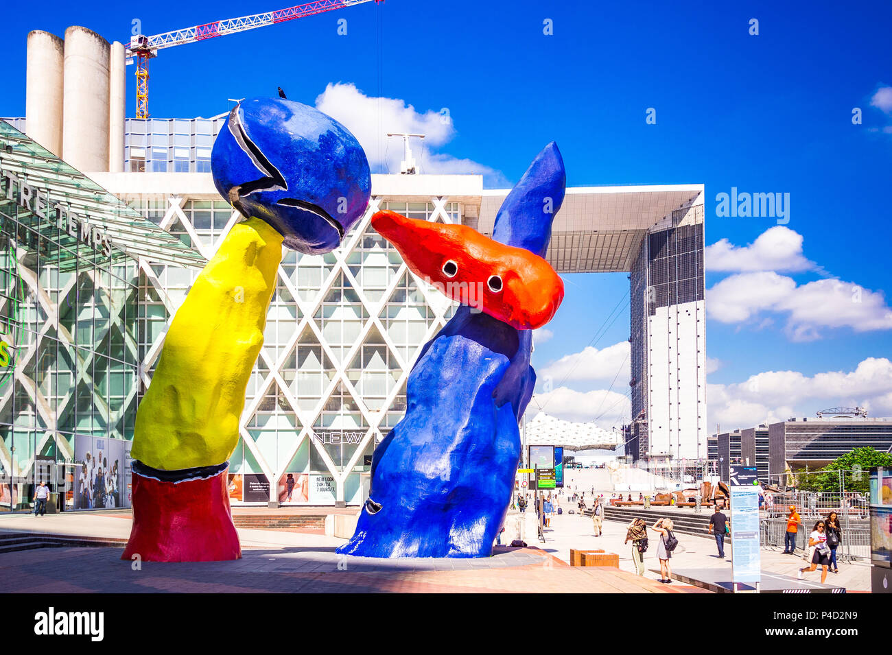"""""""Personnages Fantastiques"""" is a colourful outdoor artwork and represent two dancers playing together amongst the high-rises at La Defense,Paris, Stock Photo"""