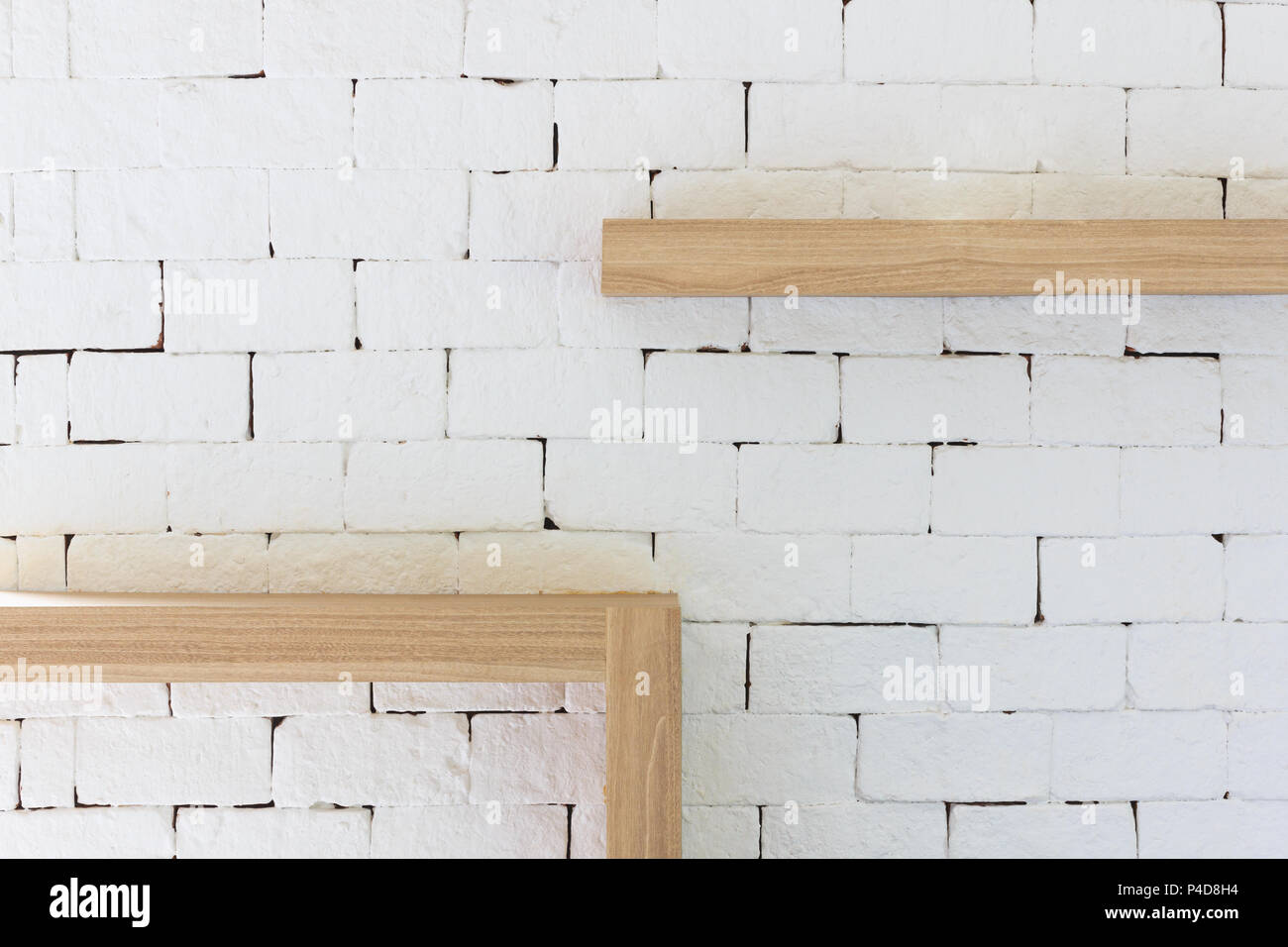 Brown wood frame on white brick background vintage furniture wooden frame hanging on white brick wall texture