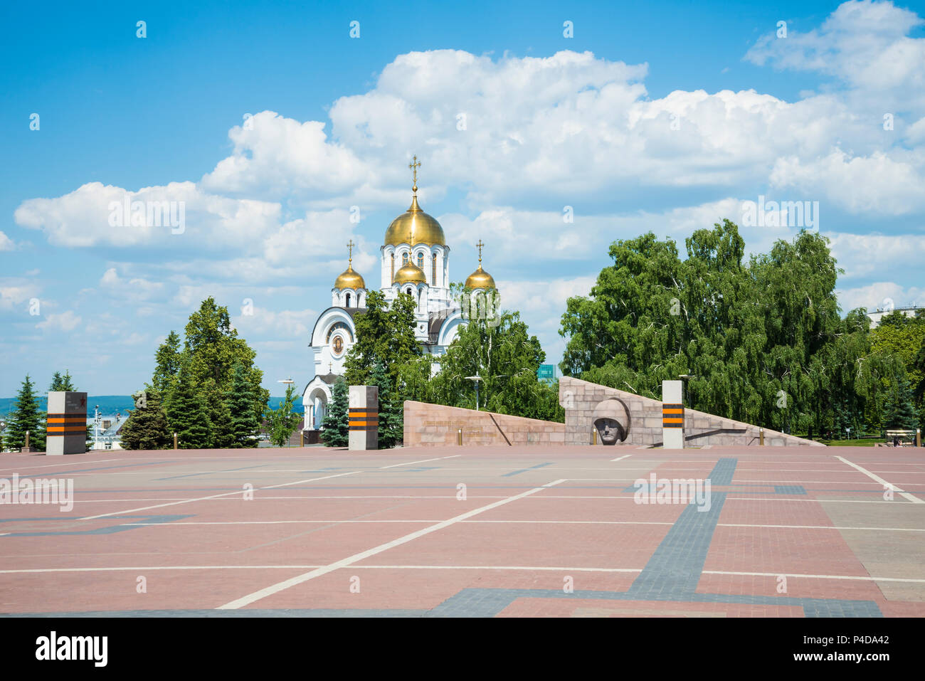 Church in honor of St. George the victorious and Memorial of the grieving mother Motherland in Victory square in Samara, Russia. - Stock Image