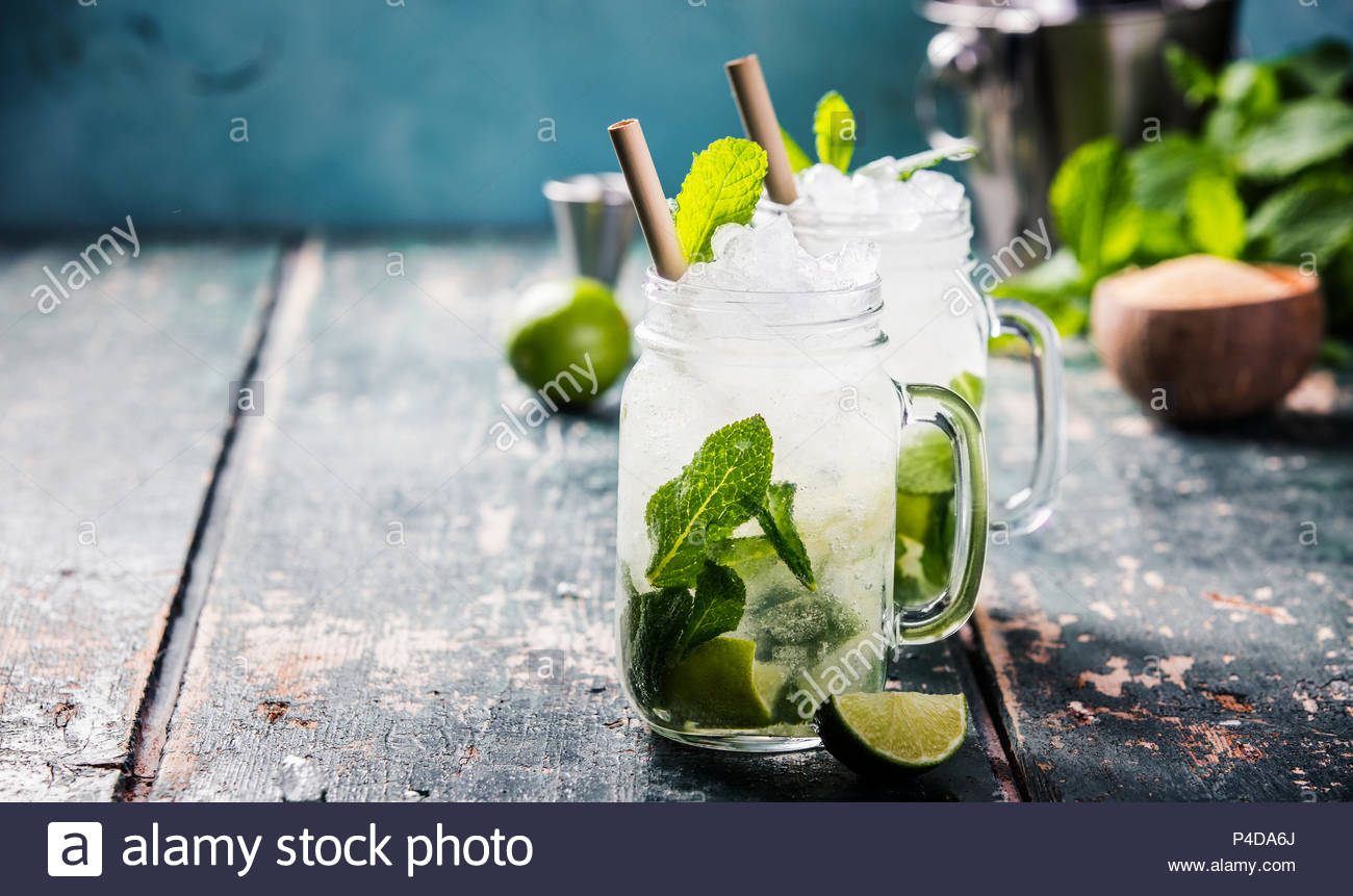 Mojito cocktail on wooden table - Stock Image