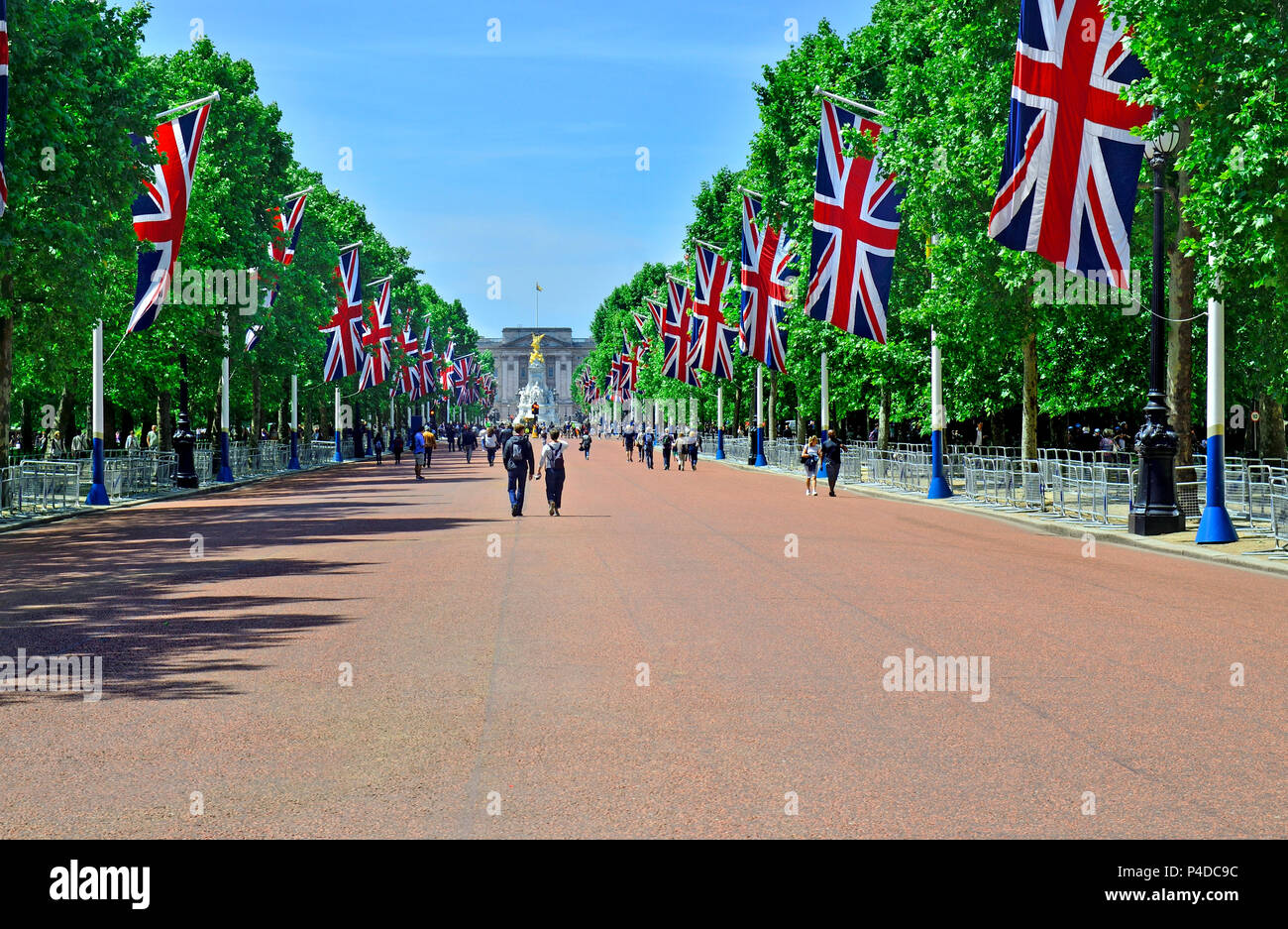 The Mall, looking towards Buckingham Palace, London, England, UK. Union Flags in place the Trooping of the Colour 2018 - Stock Image