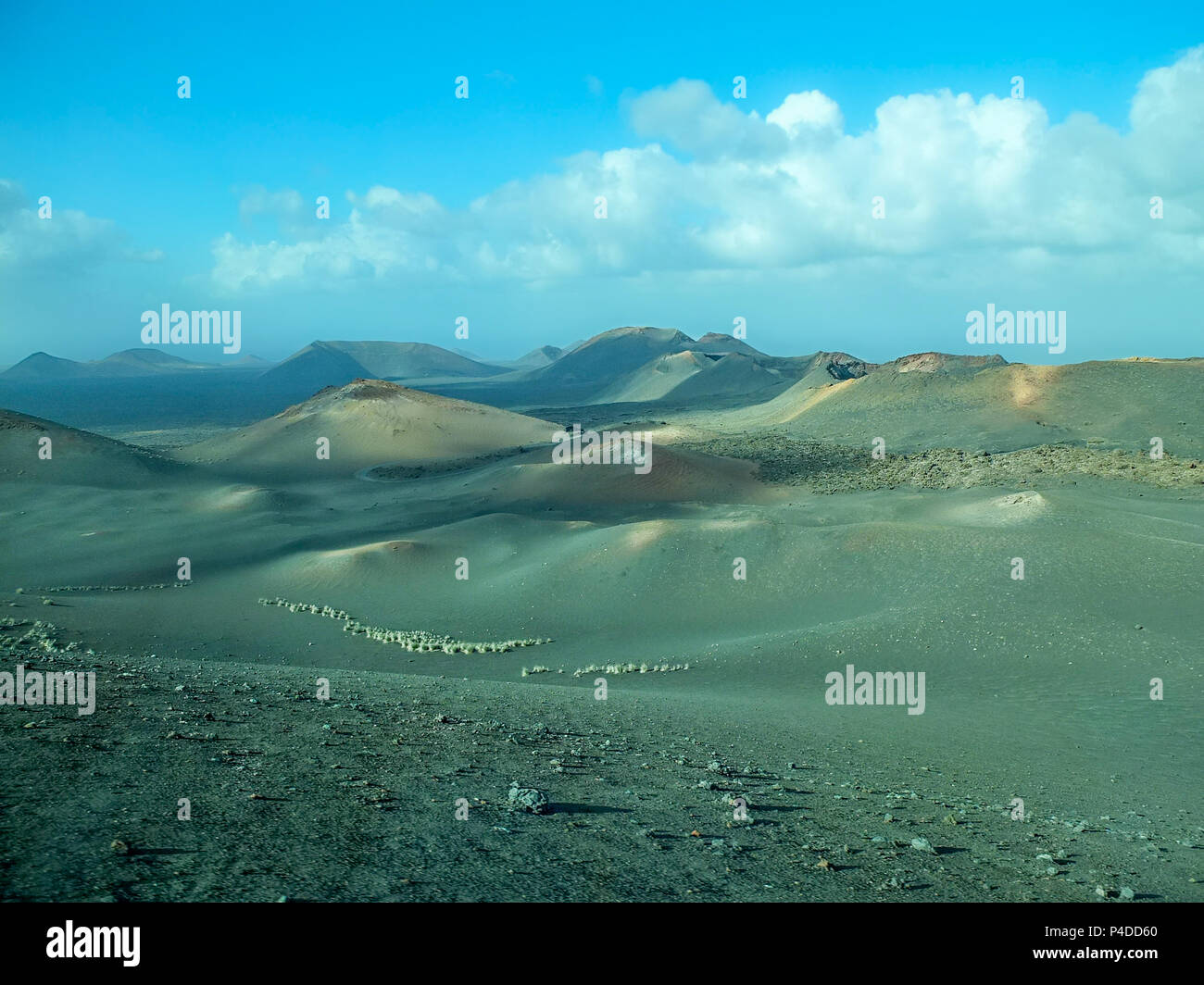 The volcanic landscapes of Lanzarote give a lunar feel and sometimes desolate depending on the time of day. The image was taken thriugh a heat haze an - Stock Image