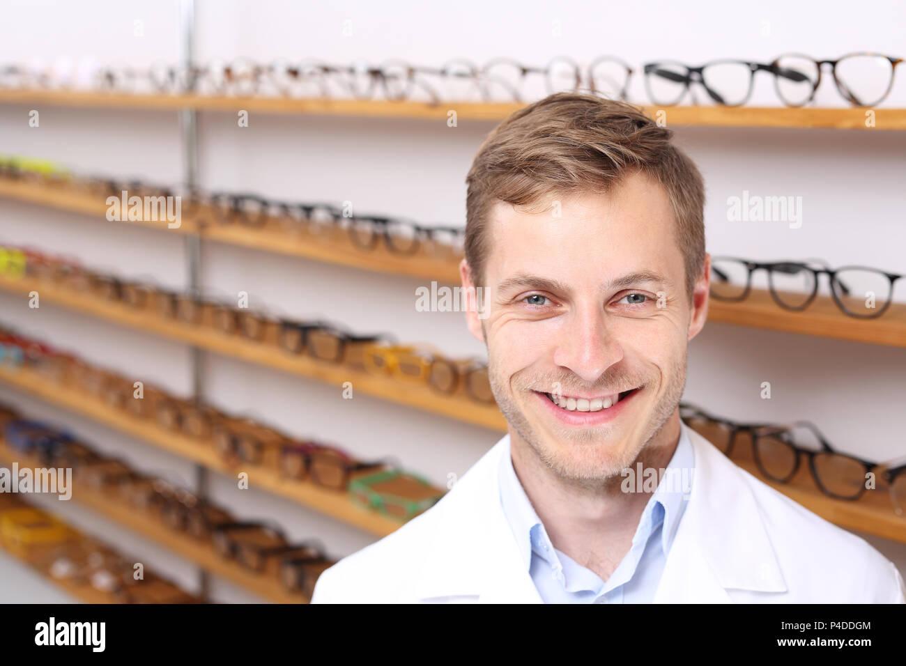 Oculist  A handsome ophthalmologist in an optical salon