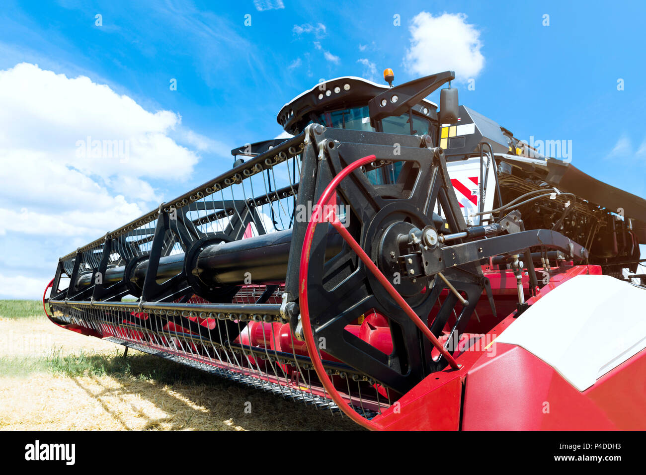 Combine harvester draper head. Agriculture heavy machinery - Stock Image