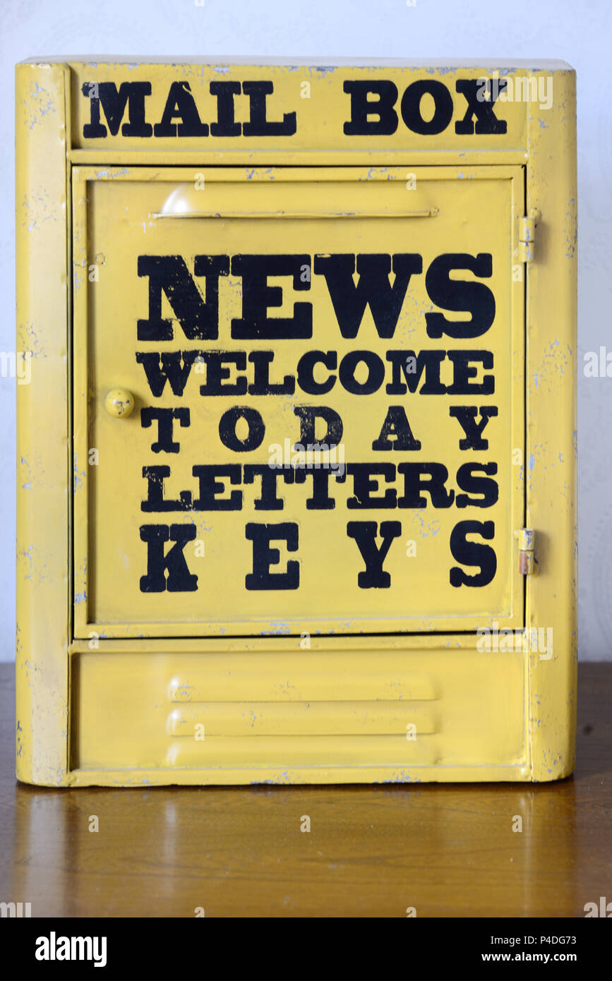 Old Yellow Mail Box or Vintage Letter Box - Stock Image