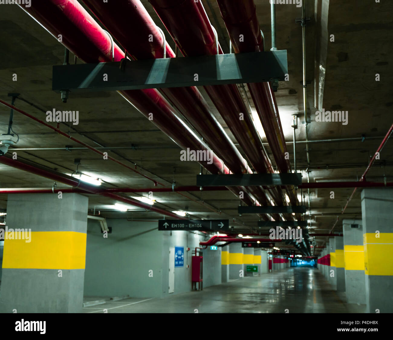 Perspective view of empty indoor car parking lot at the mall ... on indoor siding, indoor antenna, indoor generator, indoor air conditioning, indoor coil, indoor kitchen, indoor electrical wire house, indoor trim, indoor fountains, indoor fans, indoor carpet,