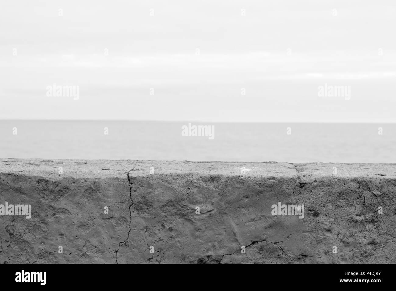 wall blocking the sea black and white photo - Stock Image