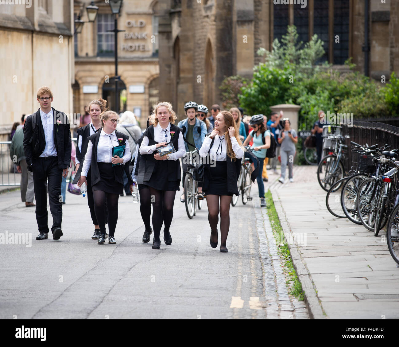 Students at Oxford University wearing tradional 'sub fusc' garments which are compulsory when taking exams. Carnations denote course year. - Stock Image