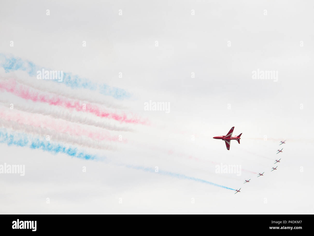 GREAT YARMOUTH, NORFOLK, ENGLAND - June 17, 2018: The Red Arrows RAF display team paint the sky in patriotic colours at Great Yarmouth's first air sho Stock Photo