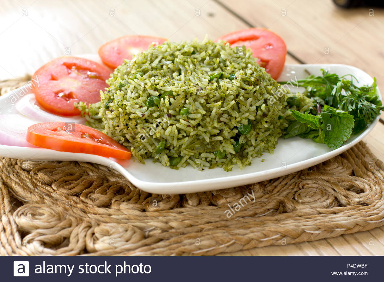 Mangalorean green rice is a simple, flavourful and delicious one pot rice dish. - Stock Image
