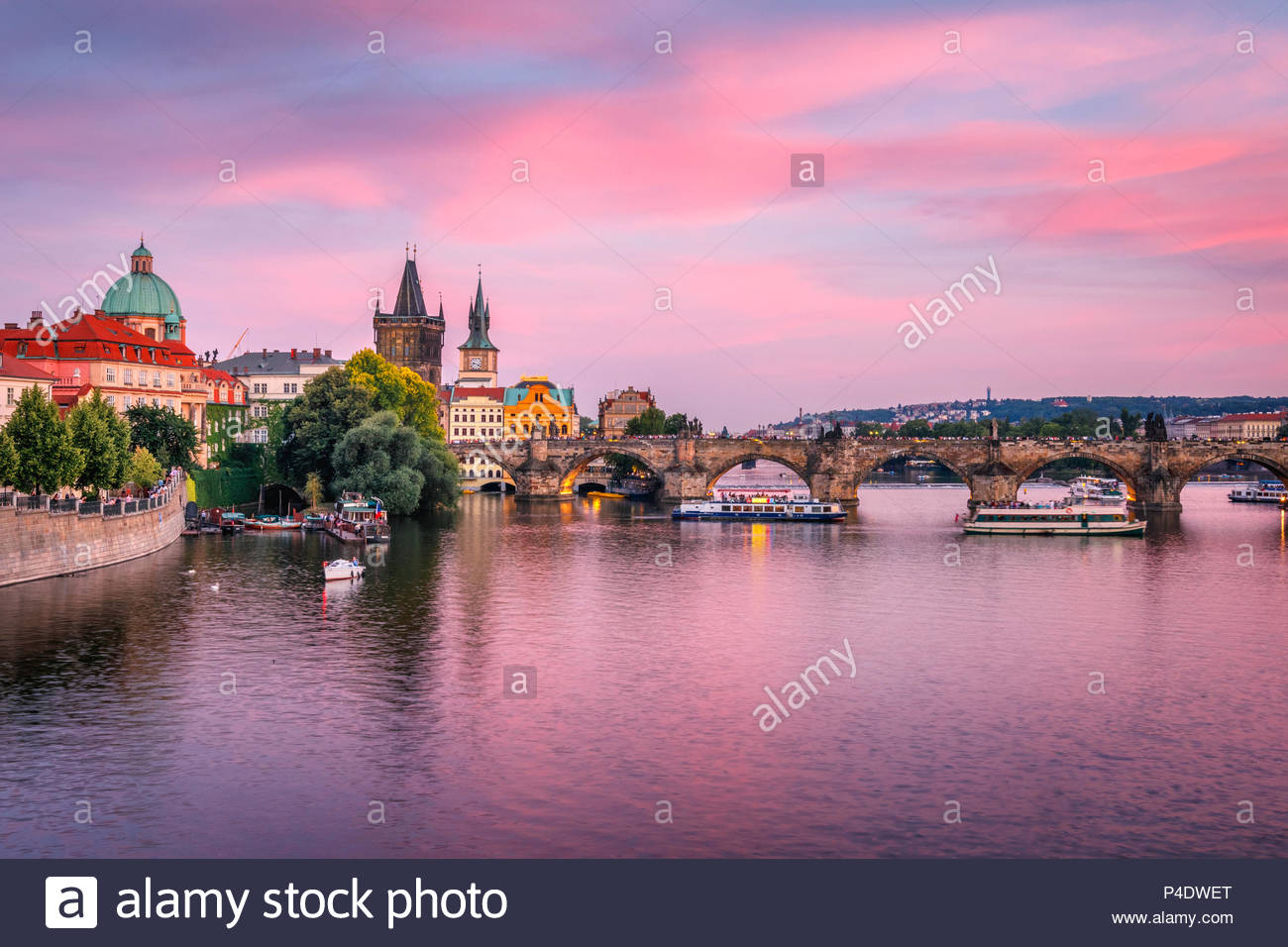 Purple sunset over Charles Bridge, Prague, Famous iconic panorama - Stock Image