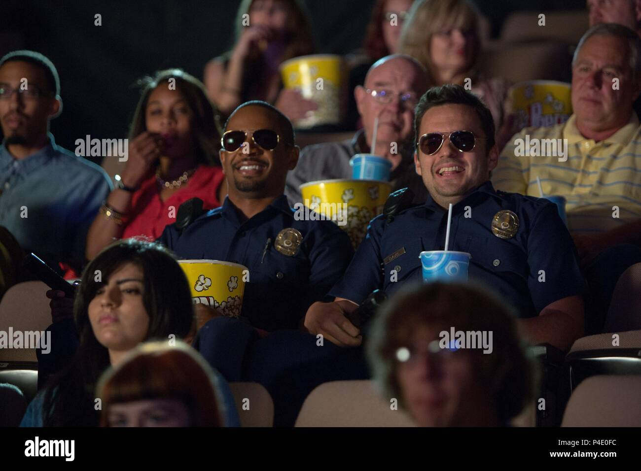 Original Film Title: LET'S BE COPS.  English Title: LET'S BE COPS.  Film Director: LUKE GREENFIELD.  Year: 2014.  Stars: DAMON WAYANS; JAKE JOHNSON. Credit: GENRE FILMS/TWENTIETH CENTURY FOX FILM CORPORATION/WIDEAWAKE / Album - Stock Image