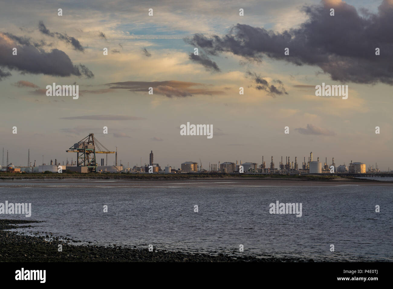 Industrial background by the north east coast of England. South Gare at Redcar. - Stock Image